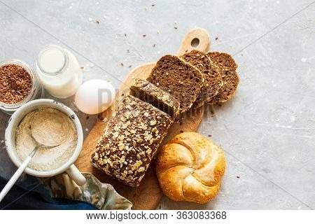 Sliced ​​bread On A Board With Milk. Tasty, Beautiful Homemade Bread With Grains. Homemade Baking. G
