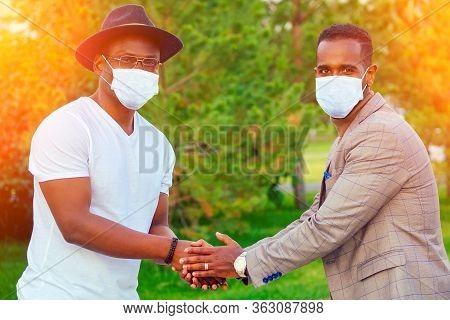 African Brazilian Friend Outdoors Hand Shaking Park Usian Antibacterial Sanitizer Gel