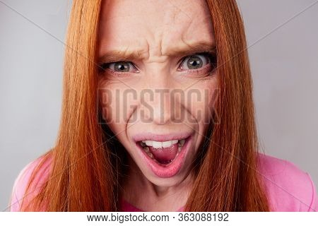Redhair Ginger Woman Feeling Angry And Irritation Studio Background Fish Eye