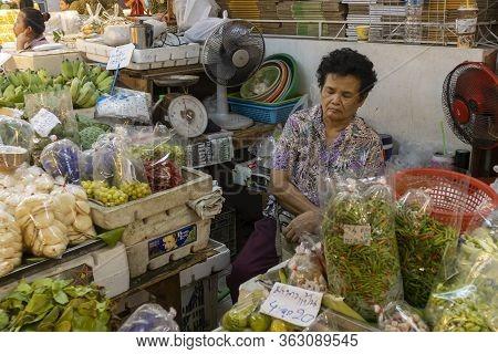 Bangkok, Thailand - March 3rd, 2020: A Fruit And Vegetable Vendor Taking A Nap In A Bangkok, Thailan