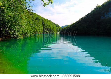 Beautiful Picturesque Plitvice Lake In The Croatian National Park. Clean Green Water In The Small Mo