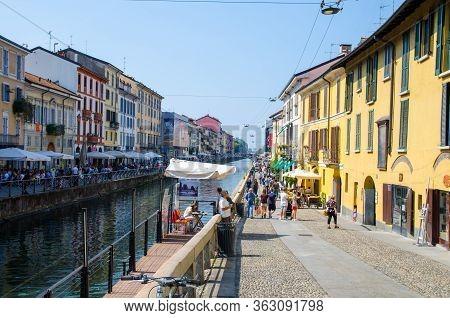 Milan, Italy, September 9, 2018: People Are Walking On Embankment, Promenade Of Naviglio Grande Gran