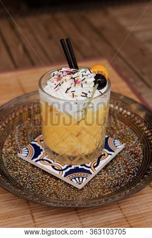 Cocktail with whipped cream served in Andalusian style