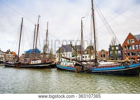 Harlingen, Nethrelands - January 10, 2020. Boats In Water Canal In Downtown In Winter