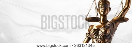 Bronze Themis Statue - Symbol Of Justice - Viewed From A Low Angle With A Smoky Background