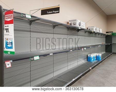 Gold Coast, Australia - March 9, 2020: Supermarket Empty Toilet Paper Shelves Amid Coronavirus Fears