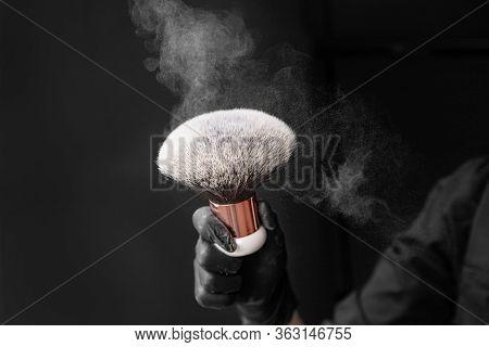 Large Brush Make Up For Applying White Powder With Dust And Splashes On Black Isolated Background
