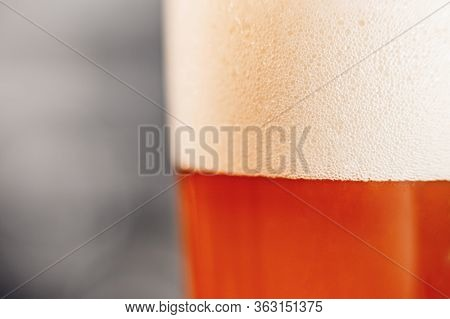 Close Up Gold Blur Background Texture Of Yellow Lager Beer With Froth And Bubbles In Glass, Copy Spa