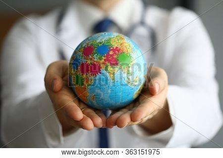 Doctor Shows Globe With Coronavirus, World Pandemic. Coronavirus Is Global Problem In World. Tempora