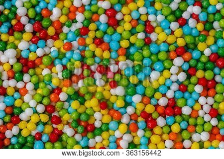 Texture Of Topping Pastry Of Colorful Easter Green, Yellow, Blue, Red, Orange, White Dragees. Backgr