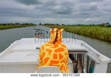 Family Vacation, Summer Holiday Travel On Barge Boat In Canal, Man In Funny Kigurumi By Steering Whe