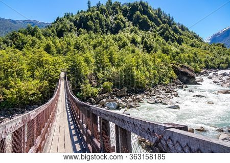 Wooden Bridge Across River Murta, Landscape With Beautiful Mountains View, Patagonia, Chile, South A