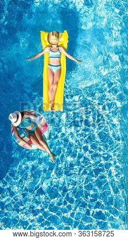 Children In Swimming Pool Aerial Drone View Fom Above, Happy Kids Swim On Inflatable Ring Donut And