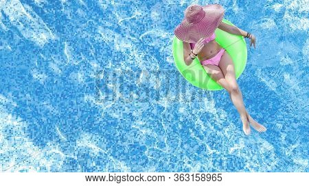 Beautiful Woman In Hat In Swimming Pool Aerial Top View From Above, Young Girl In Bikini Relaxes And
