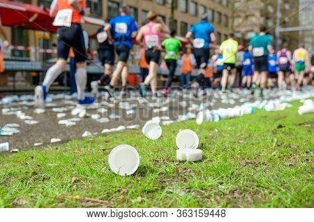 Marathon Running Race, Runners Feet And Plastic Water Cups On Road Near Refreshment Point, Sport, Fi