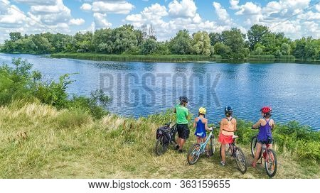 Family On Bikes Cycling Outdoors, Active Parents And Kids On Bicycles, Aerial View Of Happy Family W