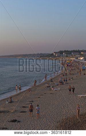 Sevastopol, Crimea, Russia - July 28, 2019: Evening On The Uchkuevka Beach In The City Of Sevastopol