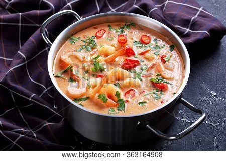 Close-up Of Tom Yum Soup, Tom Kha Soup In A Saucepan On A Concrete Table With Brown Cloth, Horizonta