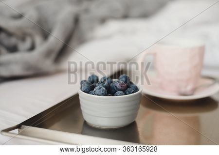 Blueberries For Breakfast Served In Bed With A Cup Of Coffee Of Pink Color On Metal Tray. Healthy De