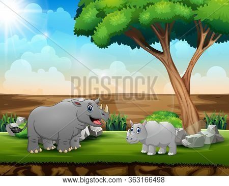 A Big Rhino With Her Cub In The Field