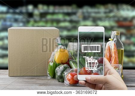 Online Order Grocery Shopping On Touch Screen Concept. Hand Holding Smart Phone With Checks The Bar