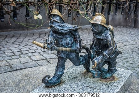 Wroclaw, Poland - December 2, 2019: Characteristic Dwarf Statuettes In Front Of Garrison Church In H