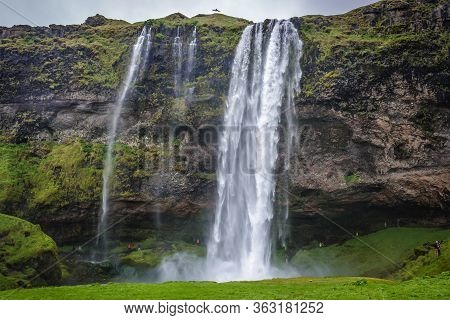 Famous Seljalandsfoss Waterfall, Part Of Seljalands River That Has Its Origin In The Volcano Glacier