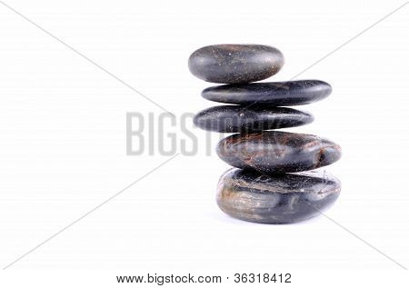 black zen stones on white backgroundt soft shadows
