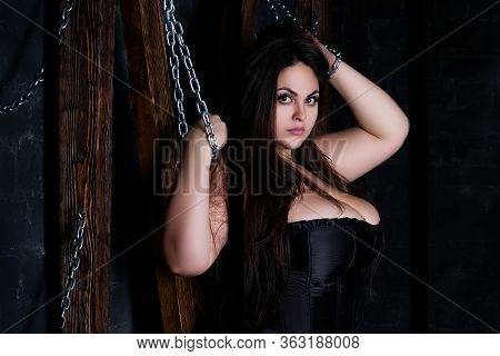Plus Size Model Tied With Chains To A Wooden Cross, Fat Woman In Sexy Clothes
