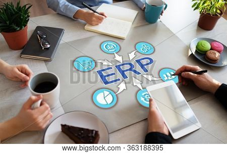 Erp Enterprise Resource Planning Business Automation Technology On Office Desktop.