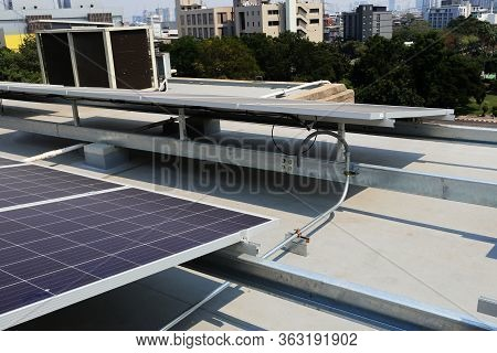 Solar Pv System On Concrete Roof Deck With Electrical Conduit Installation