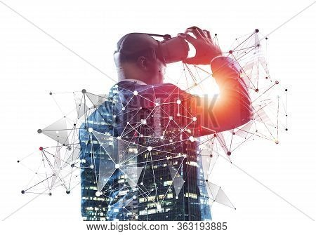 African Businessman Wearing Vr Goggles And Exploring Virtual Reality. Black Man Standing And Touchin