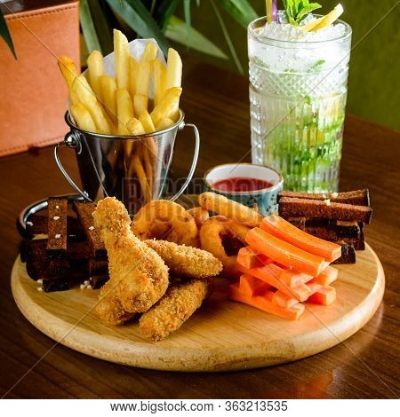 Beer Snacks On Wooden Board. Meat, Cheese Closeup Of Beer Snacks Set Cocktail Snack Tray