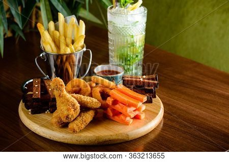 Beer Snacks On Wooden Board. Meat, Cheese Closeup Of Beer Snacks Set Cocktail Snack Tray Copy Space
