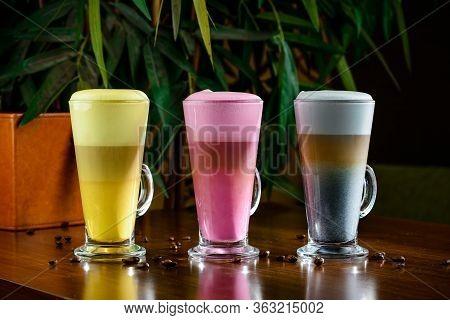 Three Colored Super Organic Lattes. Beetroot, Matcha, Turmeric Drinks. Trendy Healthy Antioxidant Dr