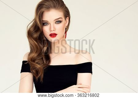 Beautiful Model Girl With Elegant Hairstyle . Woman With Red Lips And Earrings  . Cosmetics, Beauty