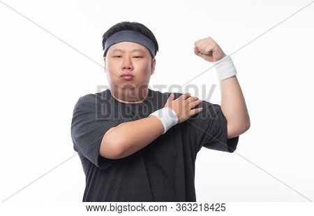 Asian Funny Fat Man In Sport Outfits Showing Strenght And Looking To Camera Isolated On White Backgr