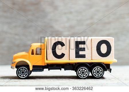 Truck Hold Letter Block In Word Ceo (abbreviation Of Chief Executive Officer) On Wood Background
