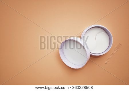 Hydrogel Cosmetic Eye Patch Jar. Cosmetic Product For Skin. Patches Under The Eyes. Collagen Mask