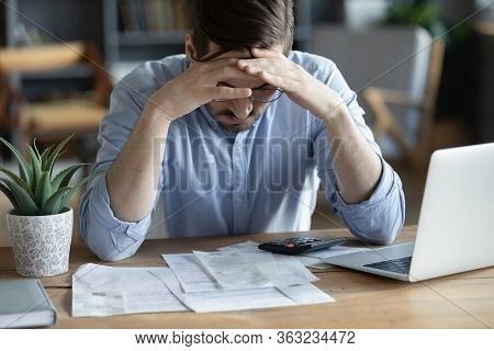 Sad Depressed Man Checking Bills, Anxiety About Debt Or Bankruptcy