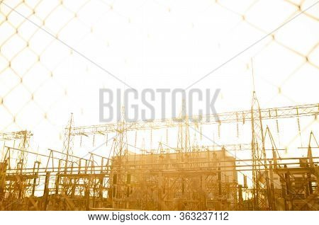 View Of Electrical Substation Through Wire Mesh