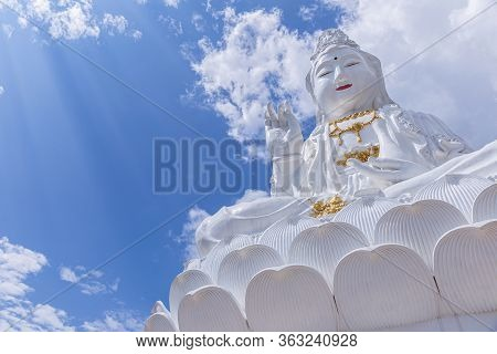 Guan Yin Statue With Blue Sky And Clouds Sky At Huay Pla Kang Temple, Chiangrai, Thailand. Aerial Vi