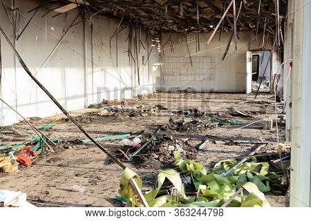 Burned Interiors After Fire In Industrial Or Commercial Building. Ruins After Fire Disaster, Loss An
