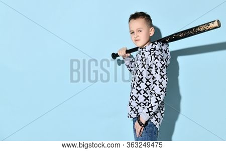 Teenage Boy In Hoodie, Jeans And Black Bracelet. He Is Grinning, Holding Black Shabby Baseball Bat O