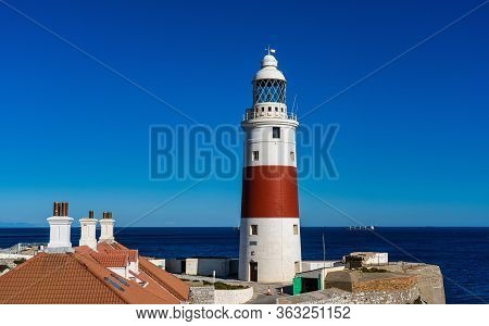 Europa Point Lighthouse, Trinity Lighthouse Or Victoria Tower. Strait Of Gibraltar On The Background