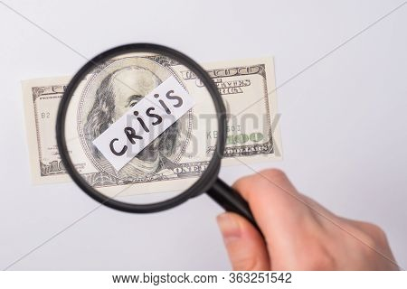 World Recession 2020 Concept. Cropped Close Up Photo Of Female Hand Using Magnifier Looking At 100 A