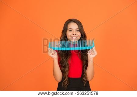 Say Goodbye To Knots And Tangles. Happy Child Hold Comb Brown Background. Hair Combing. Combing Befo