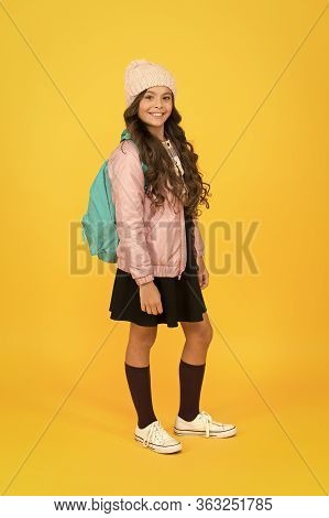 Get Ready For Back To School. Little Girl Go To School Yellow Background. Small Child In School Unif