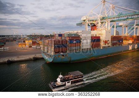 Miami, Usa - March 01, 2016: Bayride Cruise. Cruise Ship Float Along Cargo Vessel. Pleasure Cruise B