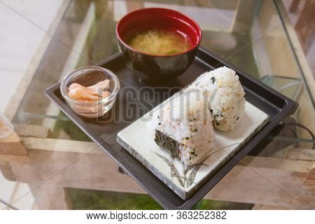 Onigiri, Japanese Food, Japanese Rice Ball, Rice Triangle With Nori Seaweed Serve With Miso Soup And